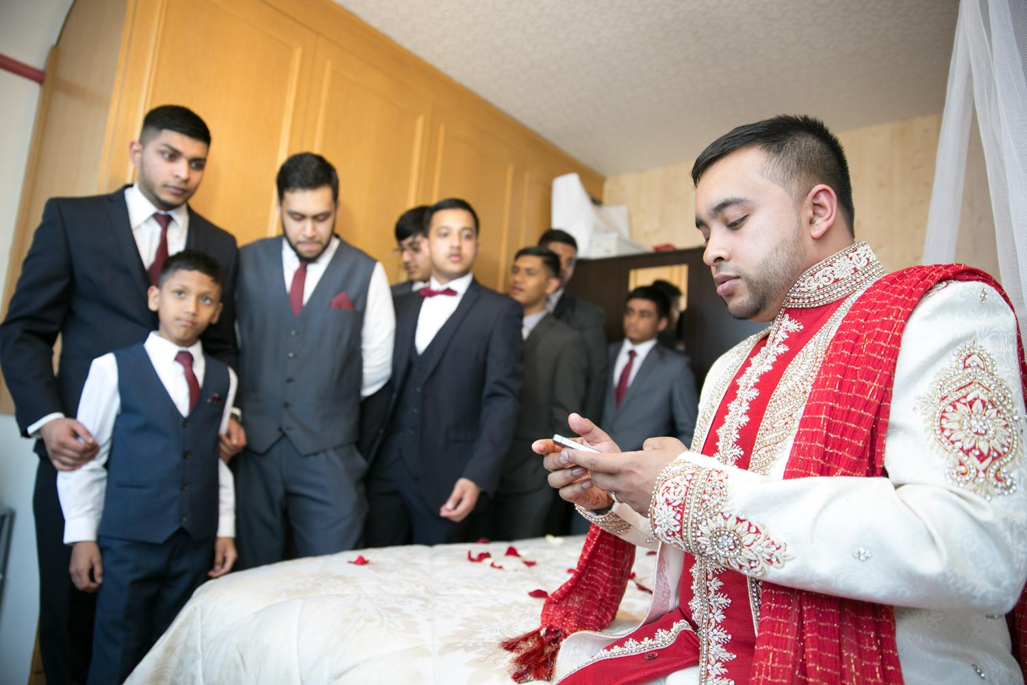 Wedding Photography of groom at home with brothers by MAKSAM Photography