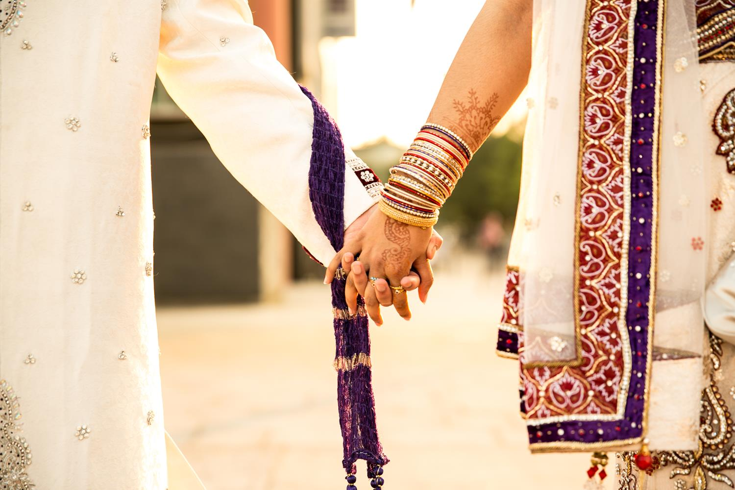 Wedding Photography of Bride and Groom holding hands in London by MAKSAM Photography