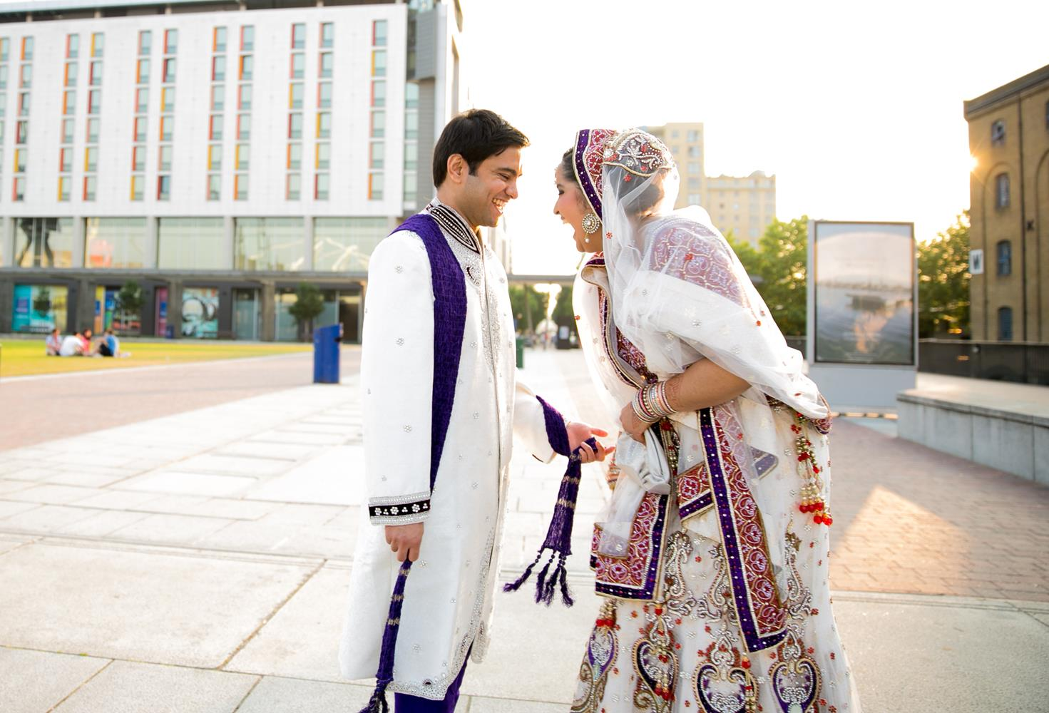 Wedding Photography of Bride and Groom laughing outside in London by MAKSAM Photography