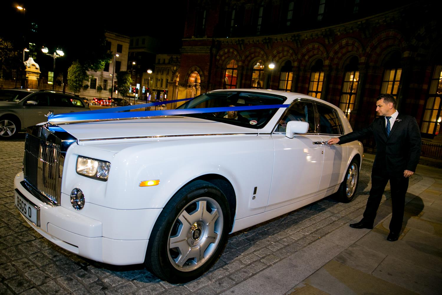 Wedding Photography of Rolls Royce outside London's Renaissance Hotel by MAKSAM Photographer London