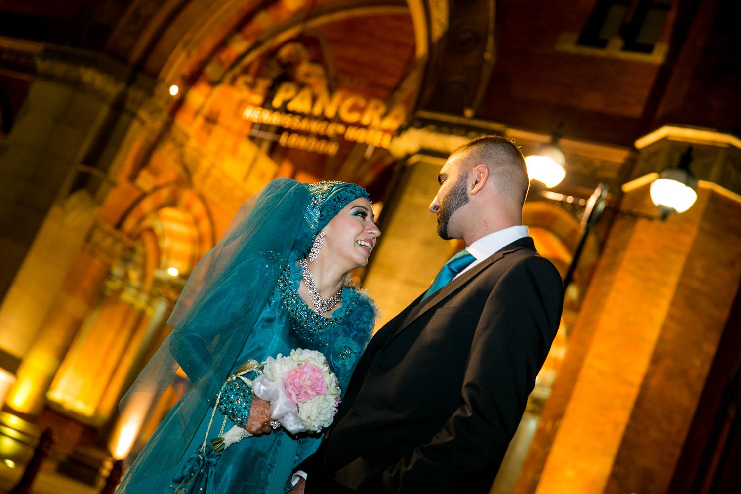 Muslim Wedding Photography of couple at their Indian Wedding by MAKSAM Photographer outside London's Renaissance Hotel