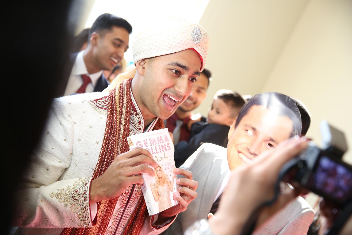 Wedding Photography of Groom arriving at gate at his Asian Wedding by MAKSAM Photography London