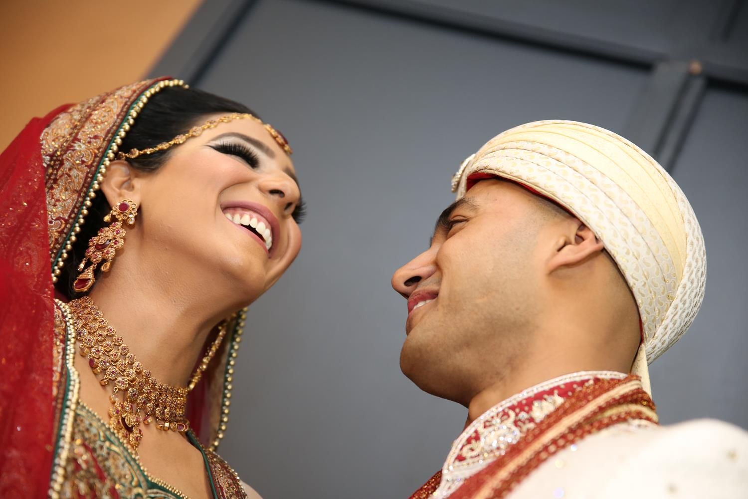Wedding Photography of Bride and Groom laughing at their Asian Wedding by MAKSAM Photography London