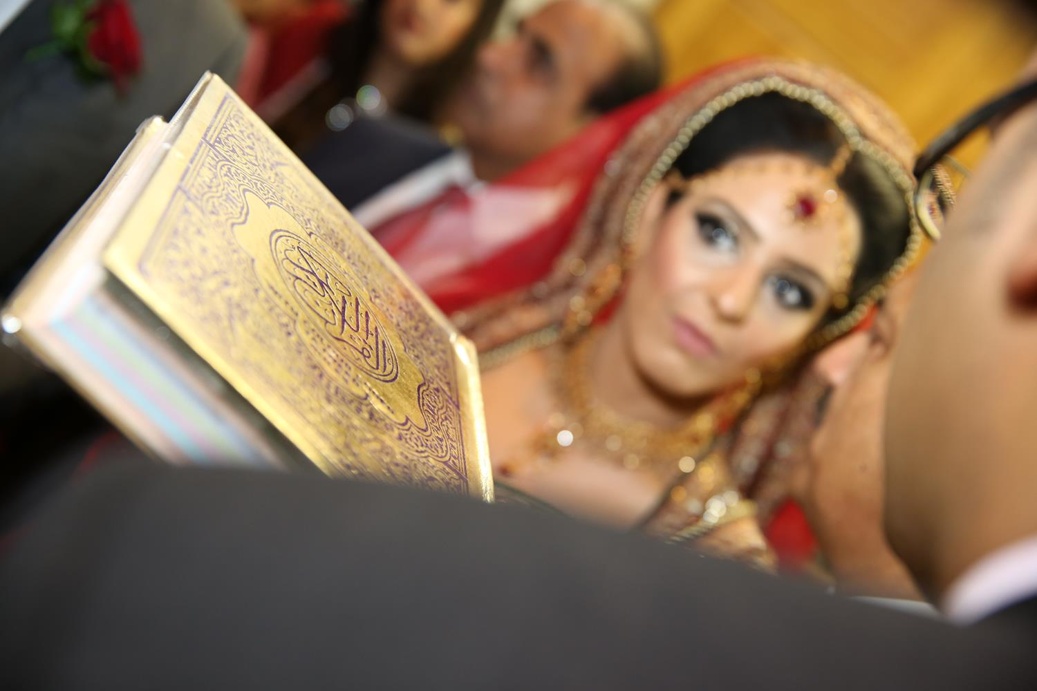 Wedding Photography of Quran following bride at her Asian Wedding by MAKSAM Photography London