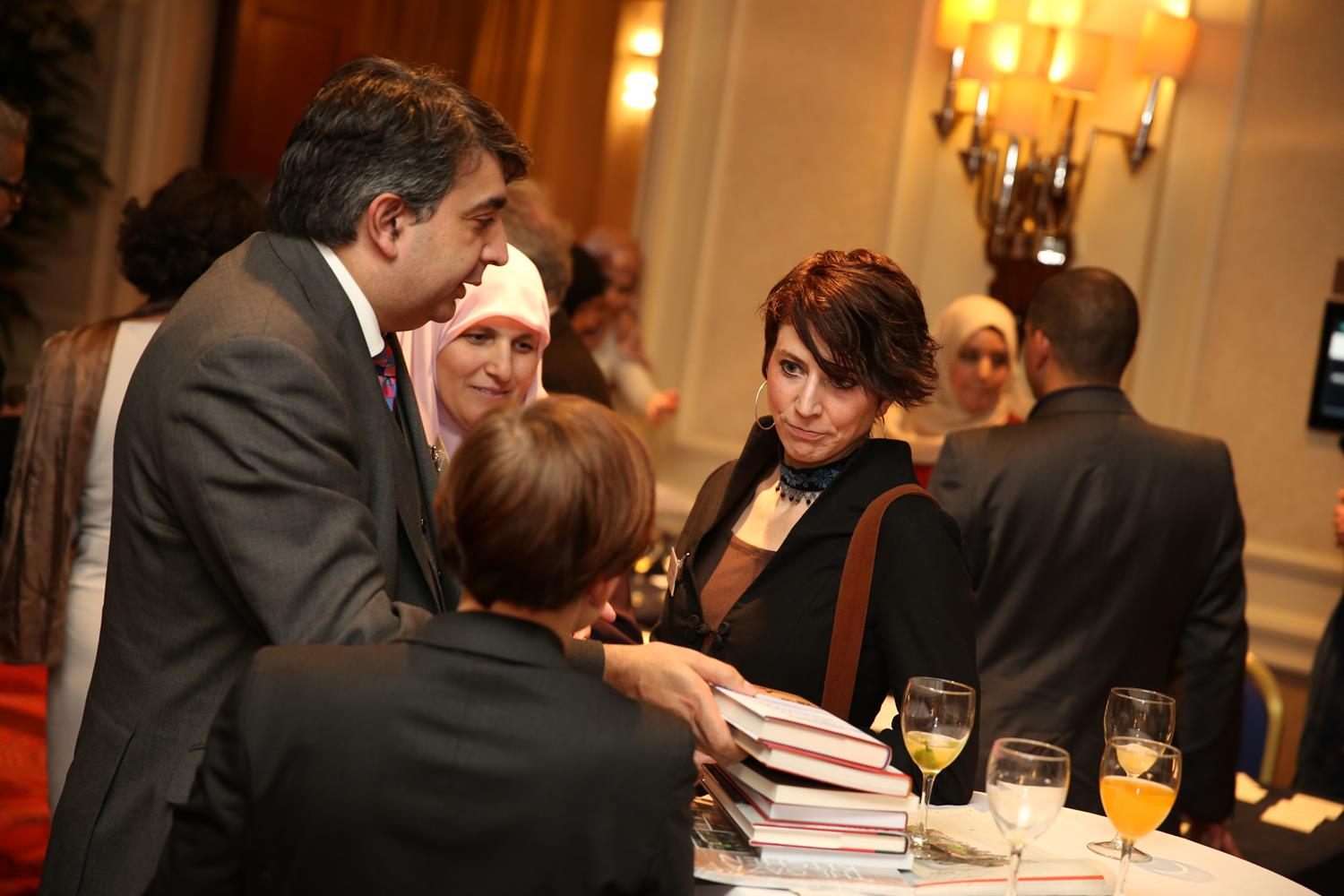 Corporate Photography of business people talking taken by MAKSAM London Photographer