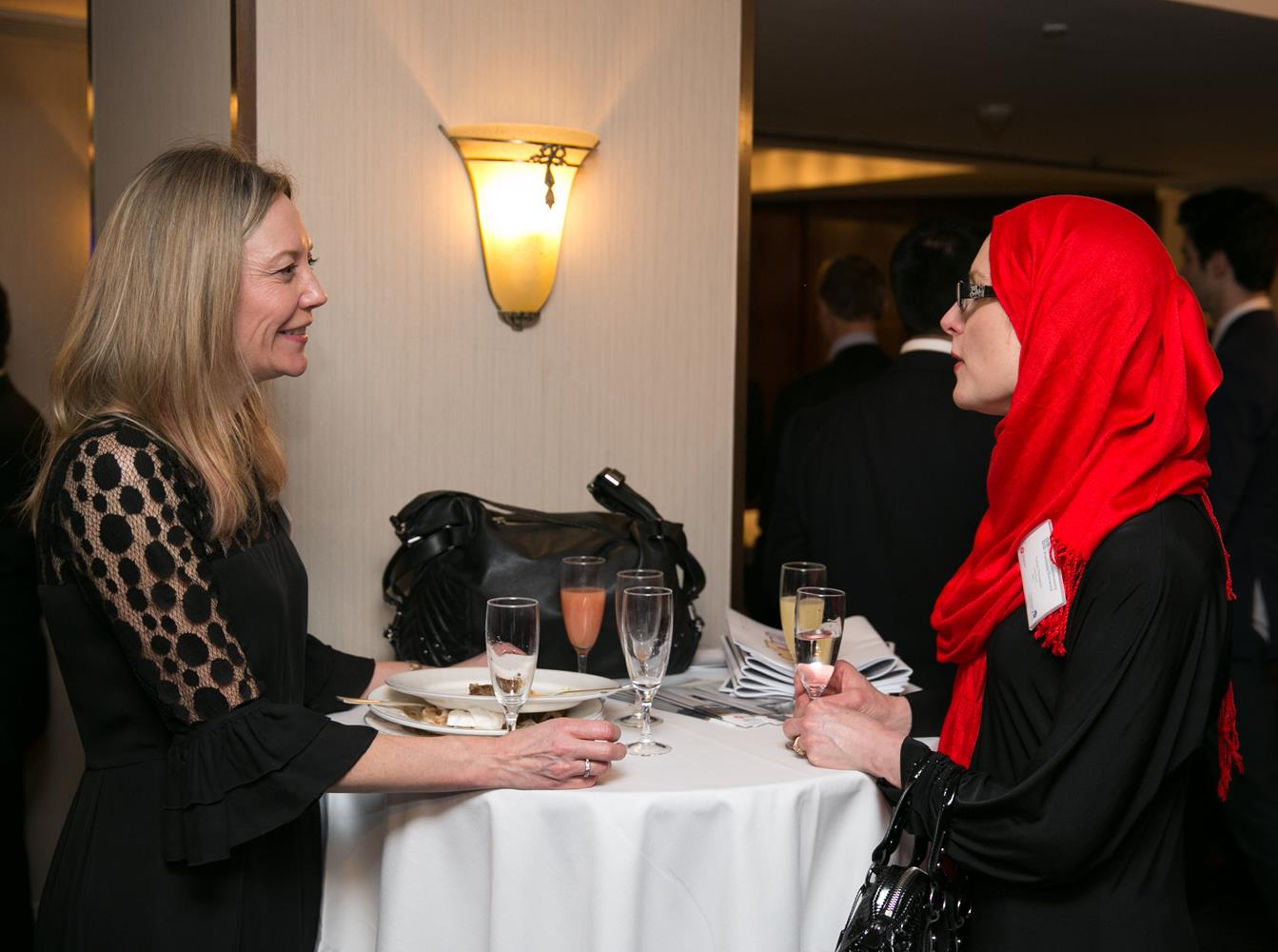 Corporate Photography of two business women in Hijab talking by MAKSAM London Photographer