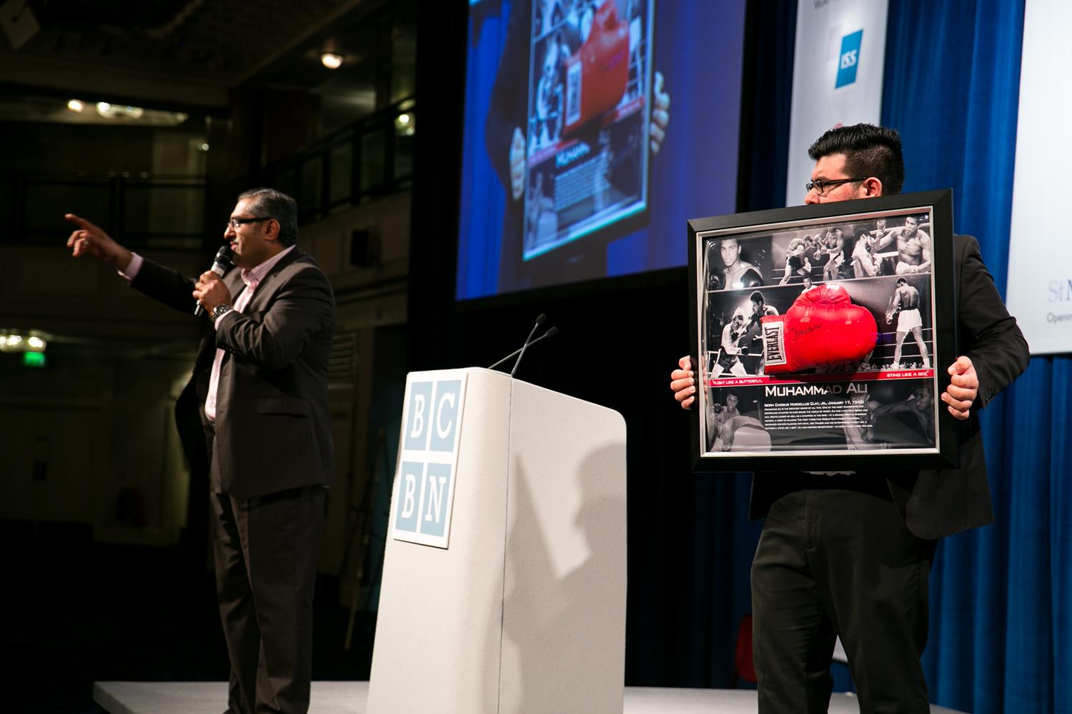Corporate Event Photography auctioning Muhammad Ali Gloves by MAKSAM Corporate photographer