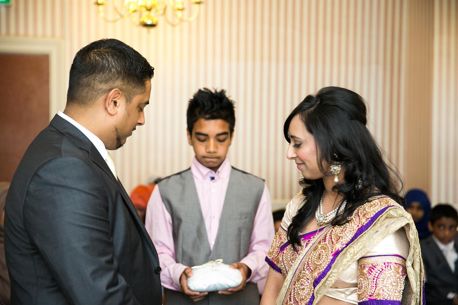 Registry Photography of couple receiving rings by MAKSAM Photography
