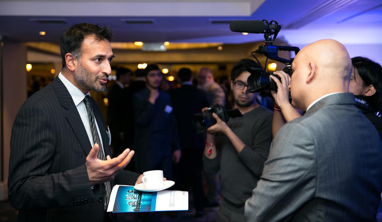 Corporate Photography of business man giving interview by MAKSAM London Photographer