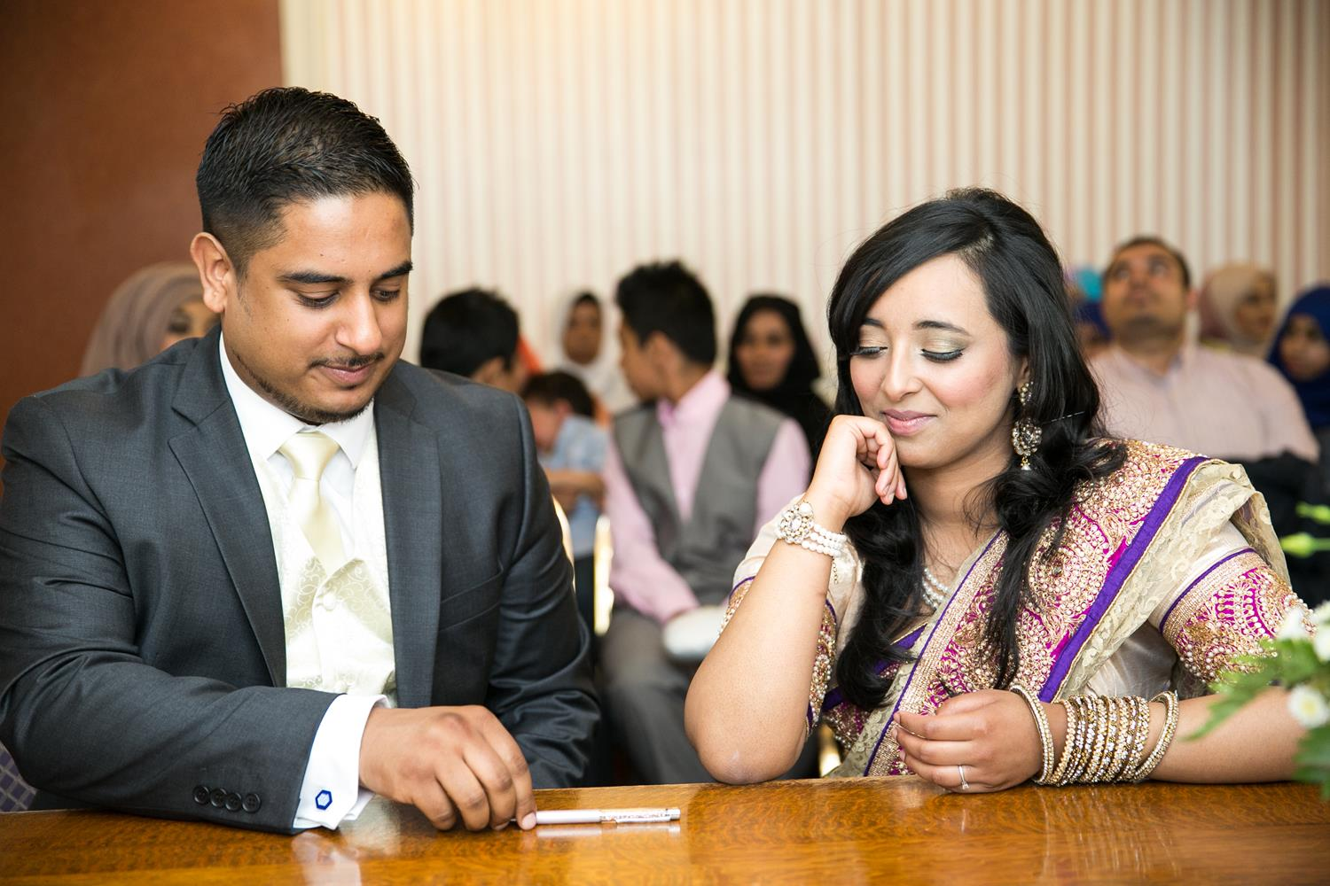 Registry Photography couple looking at pen by MAKSAM Photography