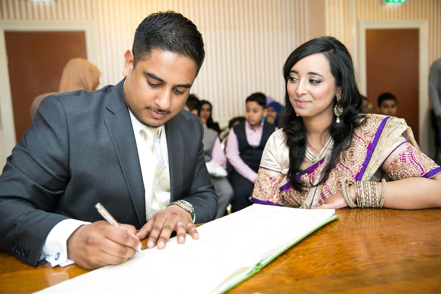 Registry Photography couple signing book by MAKSAM Photography