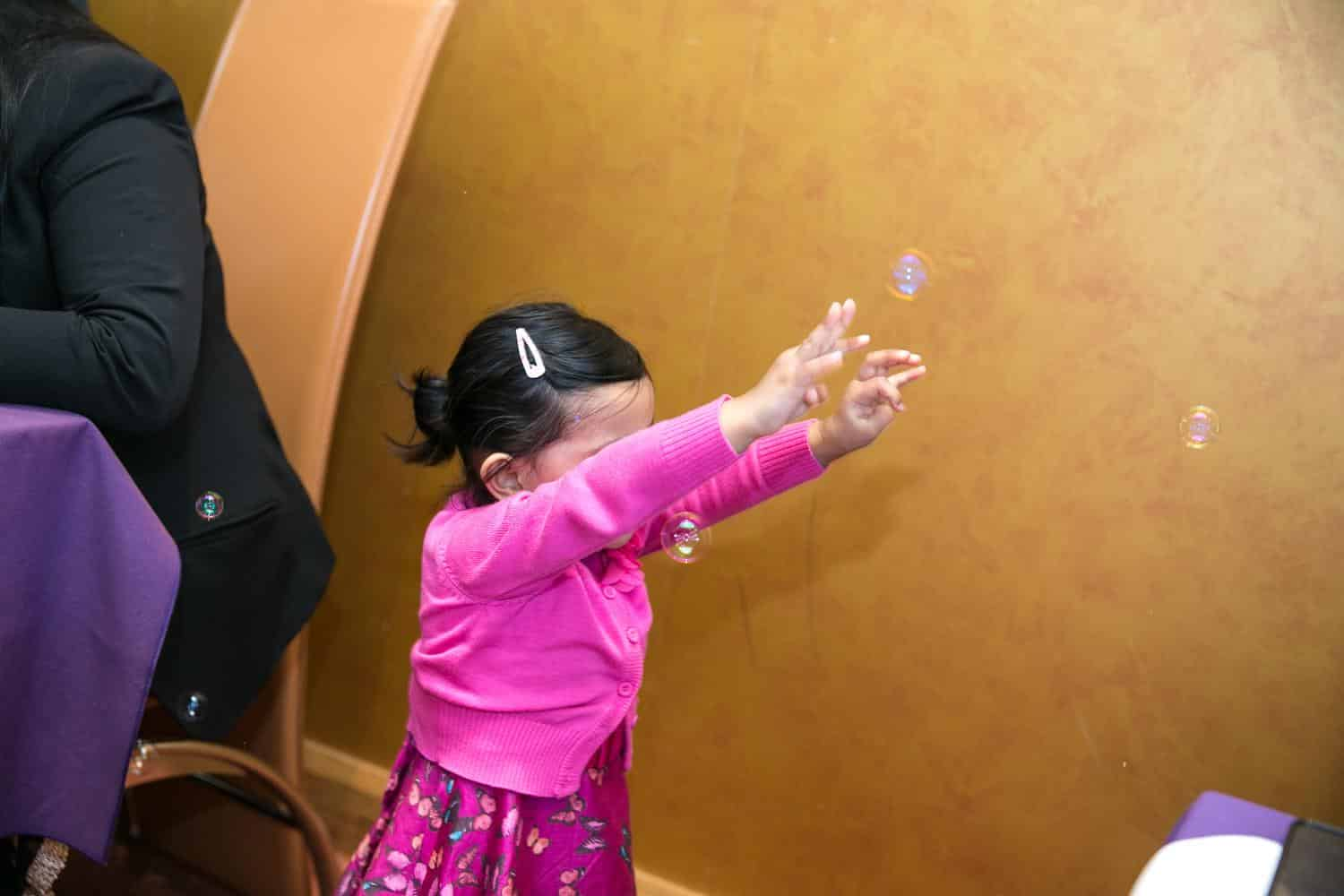 Kid playing with bubble at Wedding by MAKSAM Photography