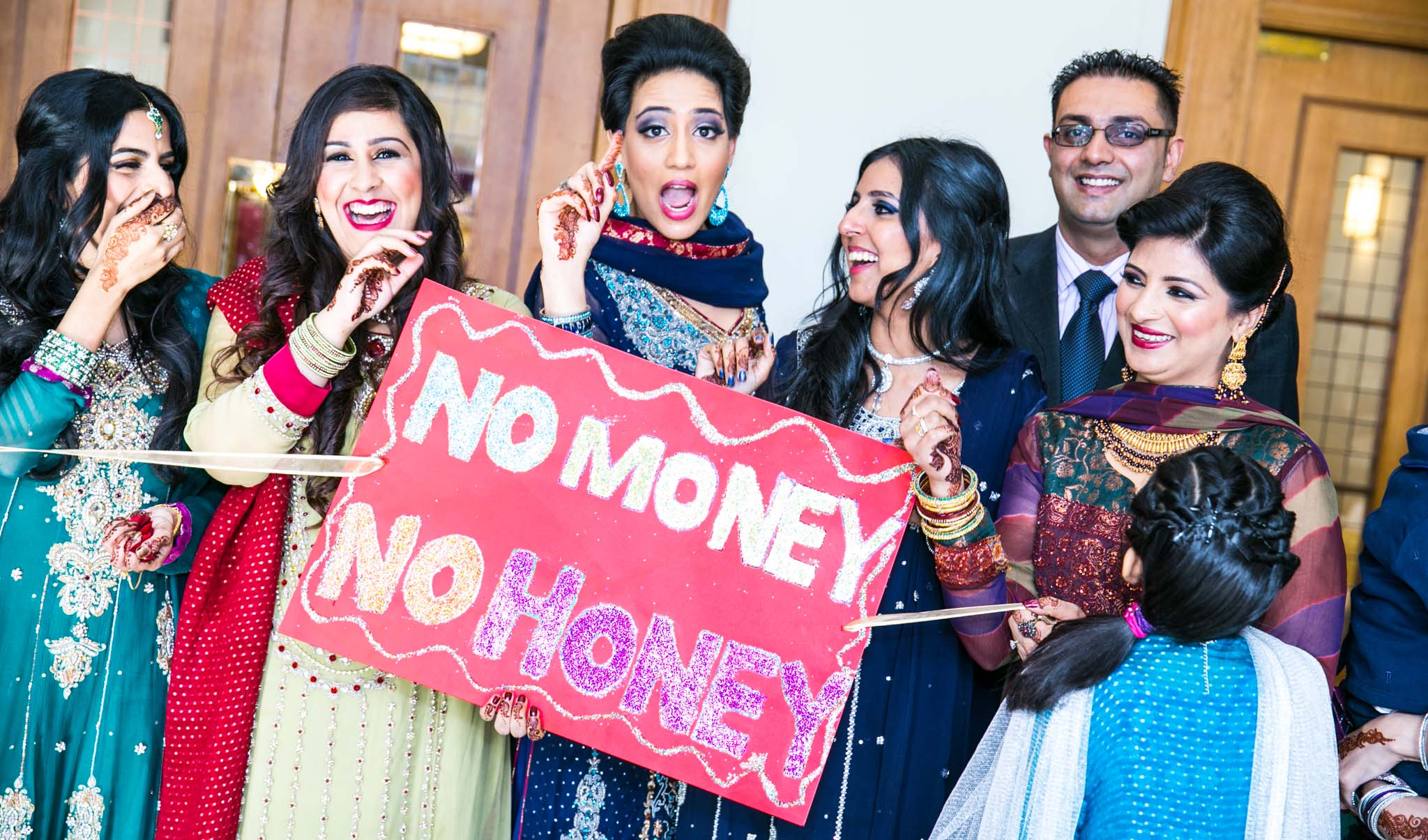 Wedding Photography of Indian wedding gate 'No Money No Honey' by MAKSAM Photography London
