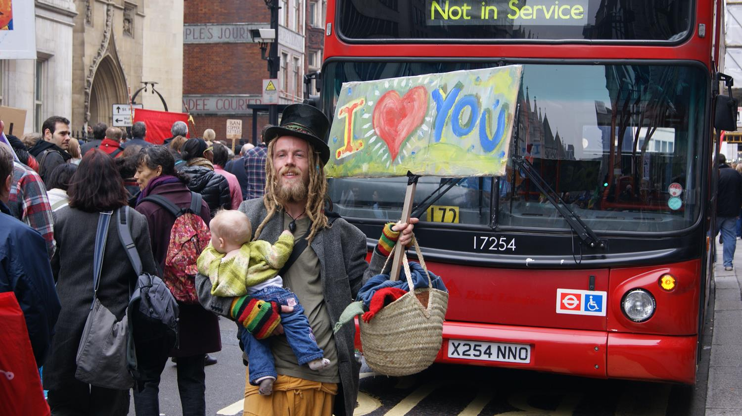 "London hipster holding ""I Love You"" banner with baby taken by London Photographer by MAKSAM Photography"