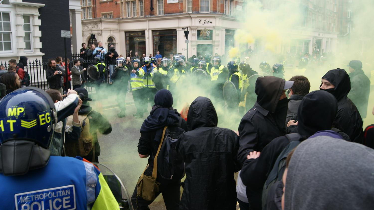 London police and smoke grenades charging at London Photographer by MAKSAM Photography