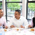 Guests at Asian Wedding Dinner Table by MAKSAM Photography