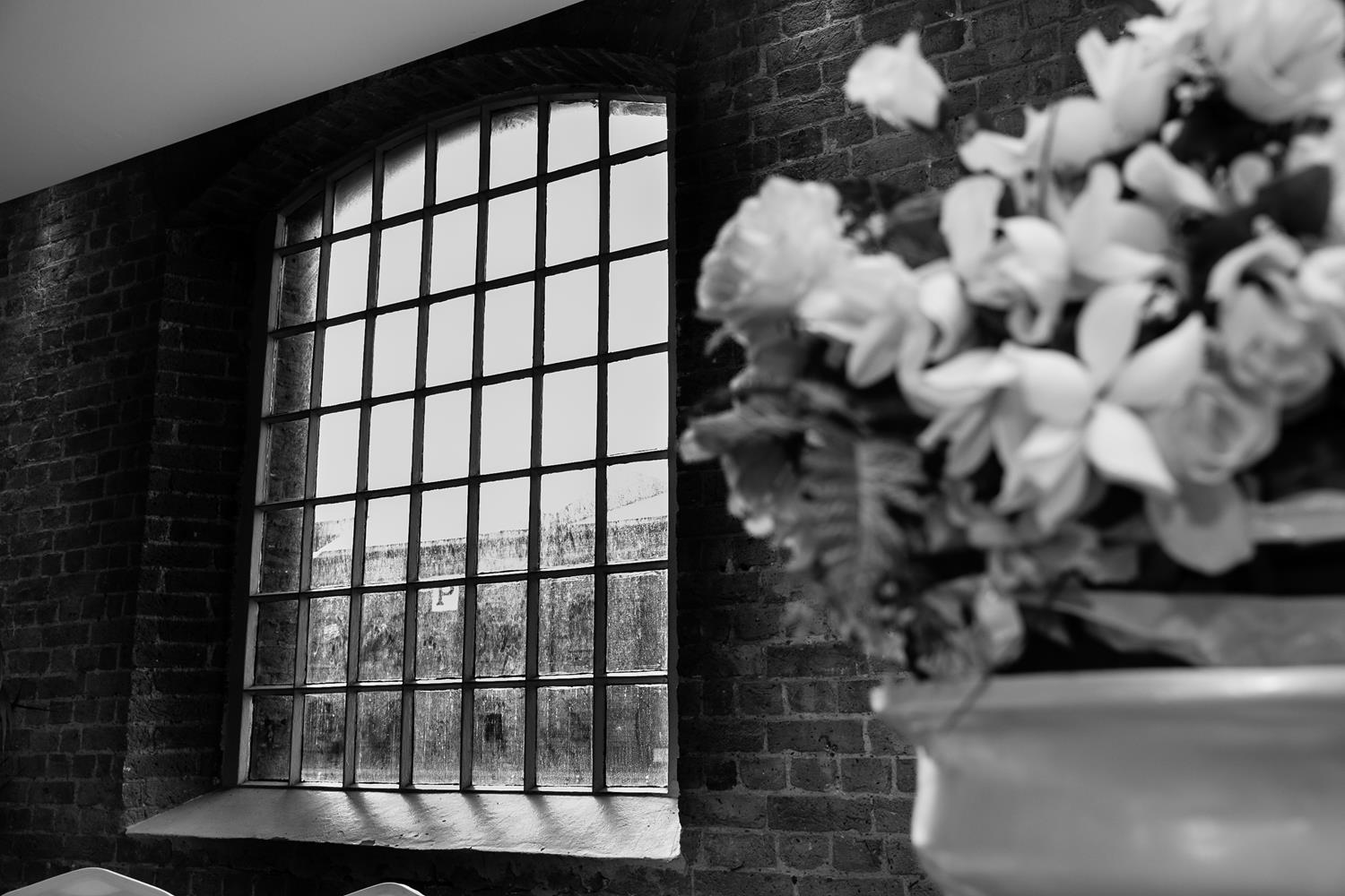 Black and White square glass window at London Wedding by MAKSAM Photography