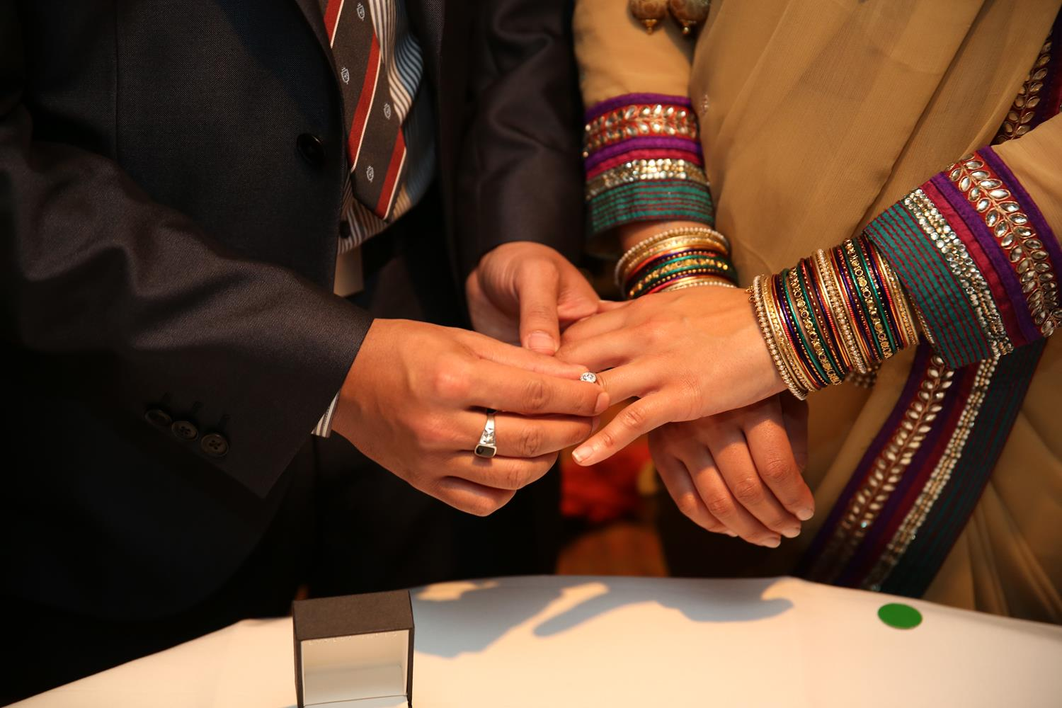 Engagement Ring exchange at Indian Wedding Photography London by MAKSAM Photography