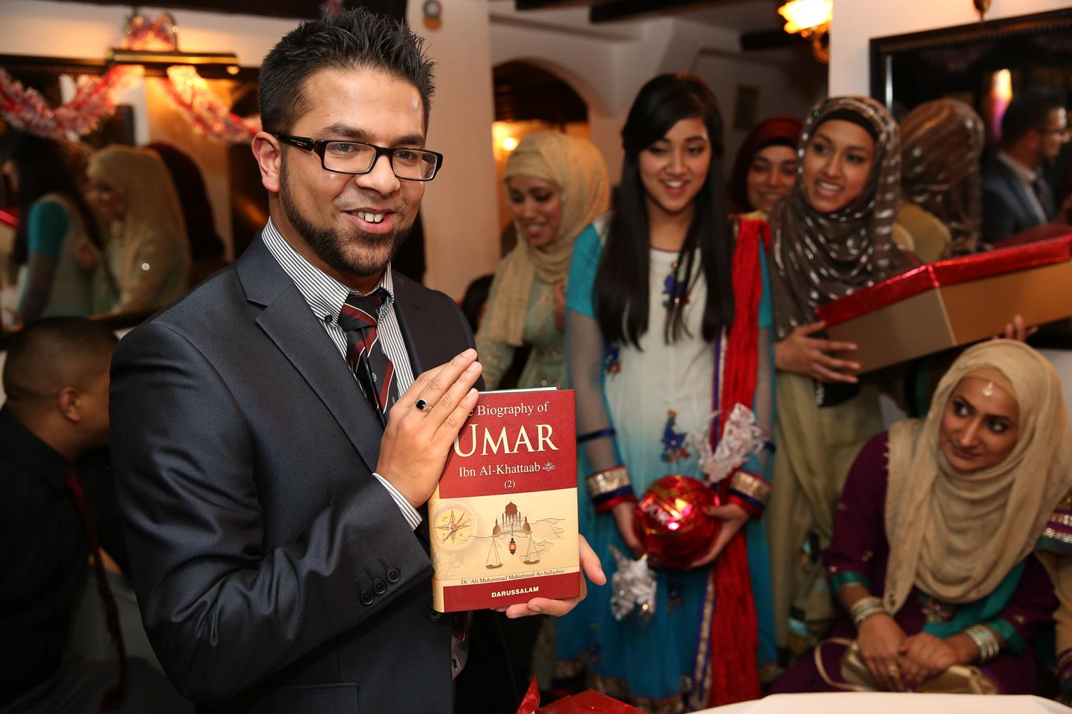 Bengali Engagement Photography Umar Ibn Al-Khattab book gift in London by MAKSAM Photography