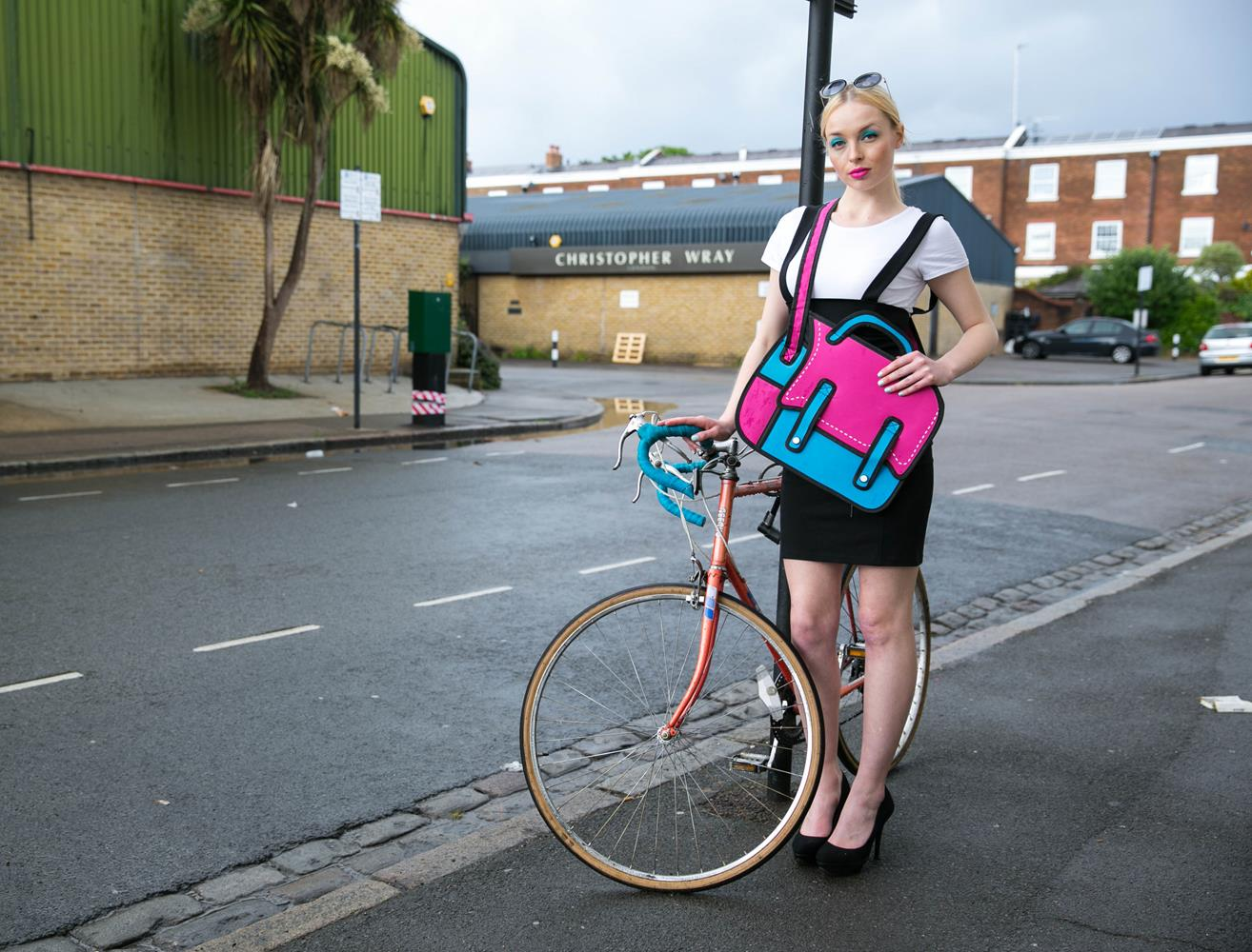 Product photography London of Model with bag and bike by MAKSAM Photography