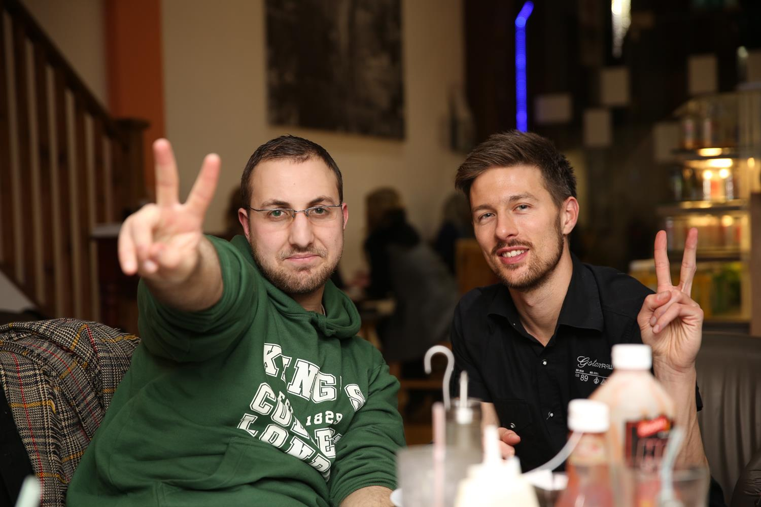 Two lads peace sign with hands by MAKSAM Photography